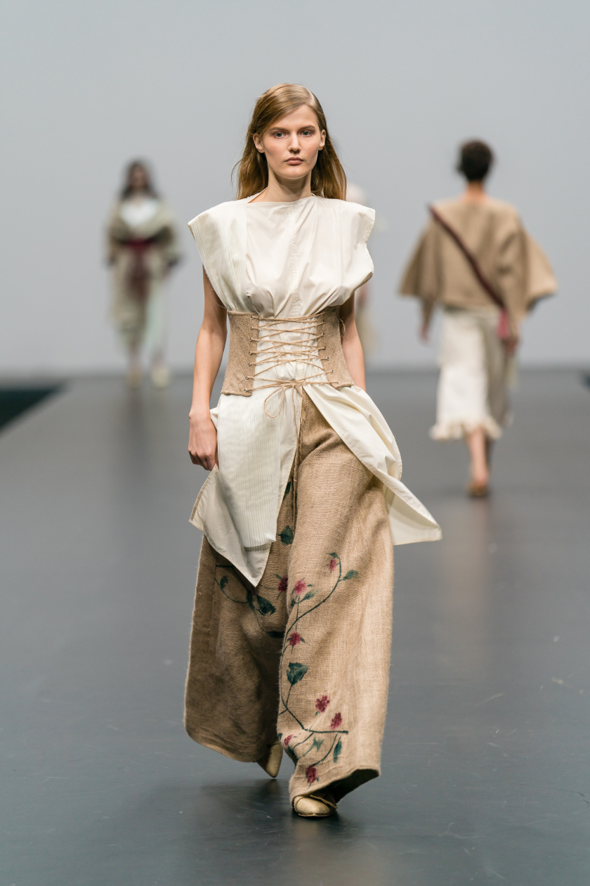 ecochic-design-award-2017-finalist_sarah-devina-susanto_up-cycled-sleeveless-cream-shirt-with-corset-and-hand-painted-floral-wide-leg-trousers-made-from-secondhand-bed-linen-and-jute-sac
